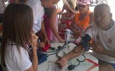 Evento ofereceu ações de conscientização e serviços à comunidade na orla da Ponta Verde