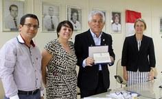 Reitor honorário Eurico Lôbo, com sua vice-reitora à época, Rachel Rocha, o chefe de gabinete, Elias Barbosa, e a procuradora-chefe da Procuradoria Federal, Valéria Ressureição